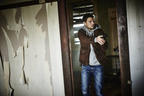 "HUNTERS -- ""The Beginning & The End"" Episode 101 -- Pictured: Nathan Phillips as Flynn Carroll -- (Photo by: Ben King/Syfy)"
